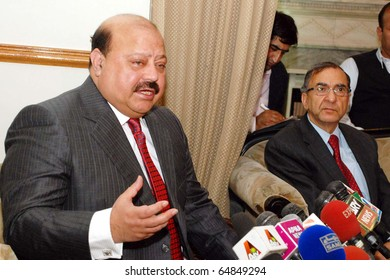 ISLAMABAD, PAKISTAN - NOV 09: Azad Jammu Kashmir (AJK) former Prime Minister, Barrister Sultan Mehmood, gestures during press conference at his residence on November 09, 2010 in Islamabad.