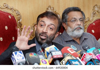 ISLAMABAD, PAKISTAN - NOV 11: Muttehda Qaumi Movement (MQM) leader, Dr.Farooq Sattar, gestures during press conference at press club on November 11, 2010 in Islamabad, Pakistan.