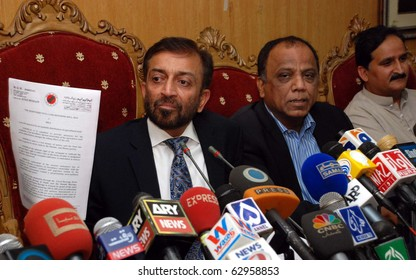 "ISLAMABAD, PAKISTAN - OCT 12: Muttehda Qaumi Movement leader, Dr.Farooq Sattar, holds copy of the ""Redistributive Land Reforms Bill 2010"" during press conference on October 12, 2010 in Islamabad."