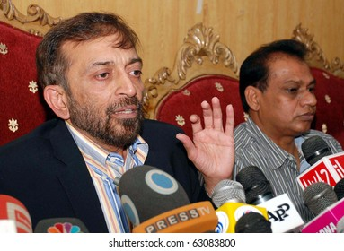 ISLAMABAD, PAKISTAN - OCT 14: Muttehda Qaumi Movement (MQM) leader Dr.Farooq Sattar gestures during press conference press club on October 14, 2010 in Islamabad, Pakistan.