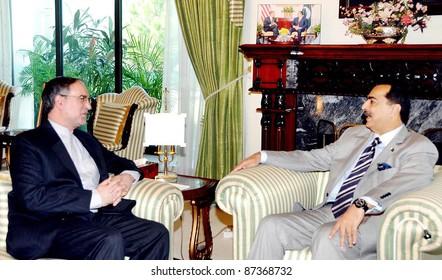 ISLAMABAD, PAKISTAN - OCT 19: Prime Minister, Syed Yousuf Raza Gilani in farewell meeting with Iran Ambassador, Mashallah Shakeri at PM House in Islamabad on October 19, 2011.