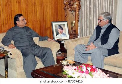 ISLAMABAD, PAKISTAN - OCT 20: President, Asif Ali Zardari in meeting with Awami National Party (ANP) President, Asfandyar Wali Khan at Aiwan-e-Sadr on October 20, 2011in Islamabad.