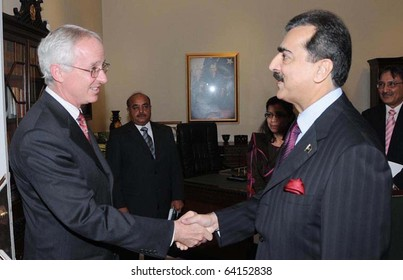 ISLAMABAD, PAKISTAN - OCT 30: Prime Minister, Syed Yousuf Raza Gilani, shakes hands with US Ambassador, Cameron P.Munter, during meeting at PM House on October 30, 2010 in Islamabad.