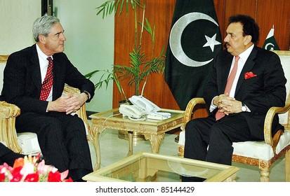 ISLAMABAD, PAKISTAN - SEPT 21: Federal Minister for Interior, Senator A.Rehman Malik in meeting with US FBI Dir, Robert S.Muller in Islamabad on September 21, 2011in Islamabad.