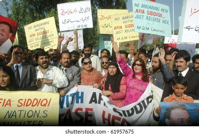 ISLAMABAD-SEPT 28: Activists of Muttehda Qaumi Movement (MQM) chant slogans for release of Dr.Aafia Siddiqui during a protest demonstration outside Islamabad press club Sept 28, 2010 in Islamabad