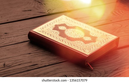 Islamic Book Koran with rosary on grey background