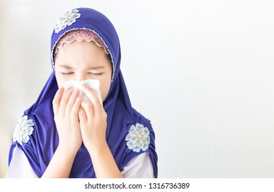 Islamic children use tissue paper close her mouth, influenza patient on gray background , health care and health promotion