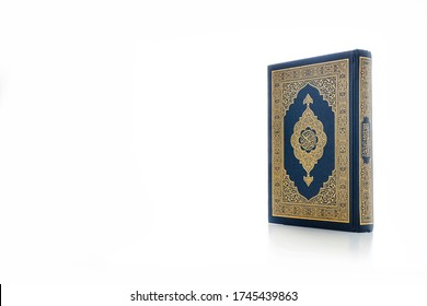 Islamic concept - The Holy Al Quran with written Arabic calligraphy meaning of Al Quran, Arabic word translation : The Holy Al Quran (holy book of Muslim), on white background, with copy space.