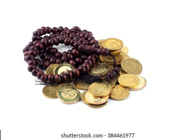 Islamic finance conceptual, rosary and coins.