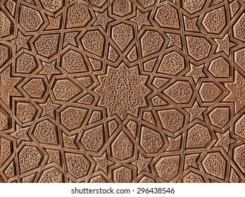 Islamic flowers and stars motif pattern, carved on the surface of an old wooden door.
