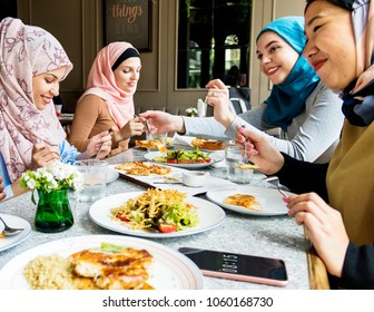 Islamic friends dining together