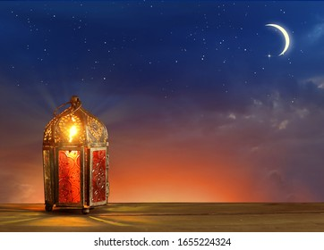 Islamic greeting Eid Mubarak cards for Muslim Holidays.Eid-Ul-Adha festival celebration.Arabic Ramadan Lantern on wooden table.Decoration lamp. Crescent moon and the stars.