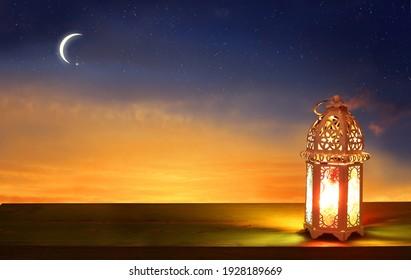 Islamic greeting Eid Mubarak cards for Muslim Holidays.Eid-Ul-Adha festival celebration.Arabic Ramadan Lantern on wooden table.Decoration lamp. Crescent moon and the stars.  - Shutterstock ID 1928189669