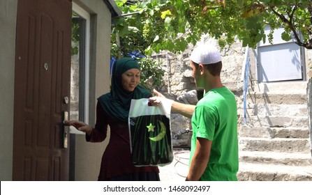The Islamic holiday Eid ul-Adha. Muslims offer a sacrifice of their own, either a goat, cow, lamb or camel. They distribute a third each among relatives and friends; and the needy