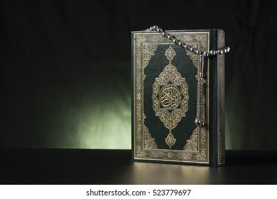 Islamic Holy Quran and Subha on Soft Light Background