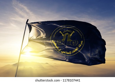 Islamic Jihad Movement in Palestine flag textile cloth fabric waving on the top sunrise mist fog