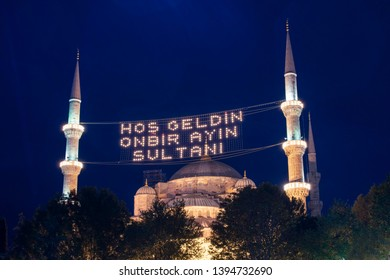 "Islamic message lettering hanging on Blue Mosque's mahya (turkish: Sultanahmet camii) is: ""Welcome to the sultan of eleven months"".  Istanbul during Ramadan (aka Ramazan) month."