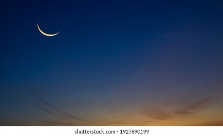 Islamic Moon sky on Dark Blue Dusk,Twilight Sky in the Evening with Sunset and Beautiful Sunlight dark cloud and Crescent moon, symbol of religion islamic begin Ramadan month, Eid al-Adha, Eid al fitr