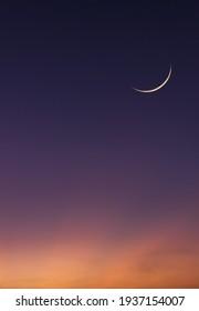 Islamic Moon sky on Dark Blue Dusk Vertical,Twilight Sky in the Evening with Sunset and Beautiful Sunlight and Crescent moon, symbol of religion islamic begin Ramadan month, Eid al-Adha, Eid al fitr