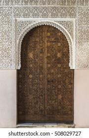 Islamic ornaments on wall. Arab symbols. Wooden door
