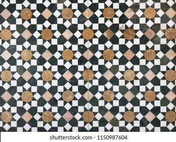 Islamic pattern of a mosaic in Moroccan style. Tiled oriental ornaments from Morocco are found in mosques and important buildings.