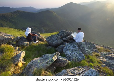 Islamic people praying on the mountain at the sunset