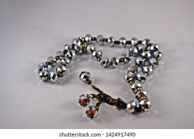Islamic prayer beads on white background