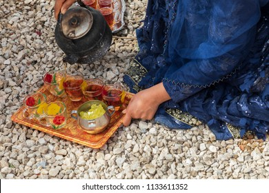 Islamic Republic of Iran. Fars Province, Fathabad Rural District, Central District of Qir and Karzin County, near Reykan village. Rural Tribal and nomadic life. Serving tea.