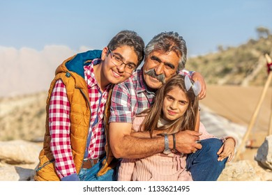 Islamic Republic of Iran.  Fars Province. Community of Qashqai nomads. Male and female family members. Modern clothing.  March 10, 2018