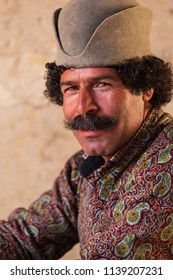 Islamic Republic of Iran.  Fars Province. Community of Qashqai nomads. Male traditional clothing and hat.  March 10, 2018