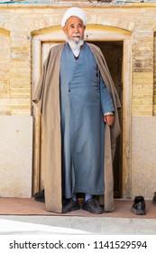 Islamic Republic of Iran. Shiraz. A Shiite Cleric leaving the Khan Madrassah.  March 08, 2018