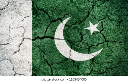 Islamic Republic of Pakistan flag on dry earth ground texture background