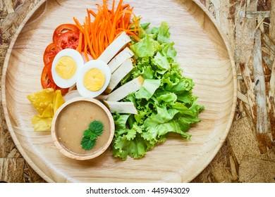 Islamic Salad on wood plate.