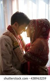 Islamic wedding ceremony, Vintage tone, Retro filter effect, Soft focus, Low light.