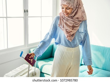 Islamic woman preparing to travel