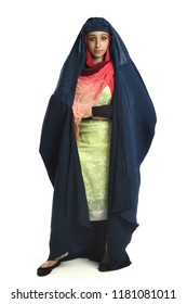 Islamic young woman wearing burqa with arms crossed isolaed over white background