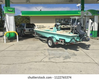 Islamorada. FL / USA - 03/04/2016: New Hells bay poling skiff in front of gas station. Stylized dramatic look. Boat on trailer. Seafoam color