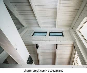 Islamorada, FL / USA -  11/15/2017: Tropical house ceiling detail with all white wood bead board and beams with high windows. Architecture