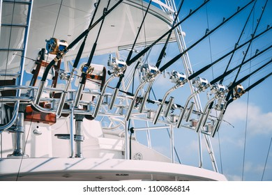 Islamorada, Florida / USA - 05/20/2018: Sport fishing boat  tower and steering station with rods in holders - horizontal view
