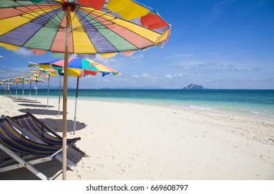 The Island beach is a very beautiful island in phuket thailand. The beach umbrellas is a colorful on the beach.