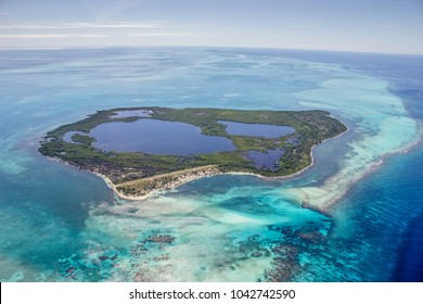 An island in the Belize Barrier Reef seen from above