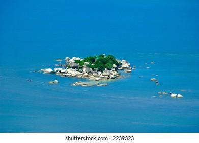 Island in blue sea