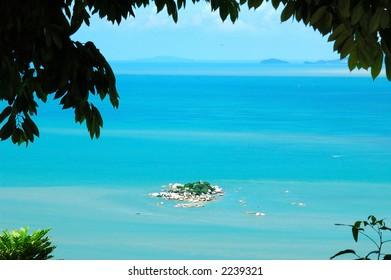 Island in blue sea and sky
