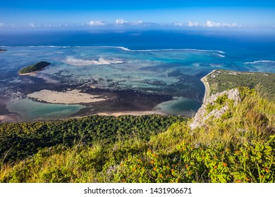 Island coastline. Ocean coastline. Relaxing panoramic ocean coastline view from the top of the mountain. Sea sand and Sun. Calm ocean and clear blue sky. Idillic Scenic tranquil landscape. Zen-like.
