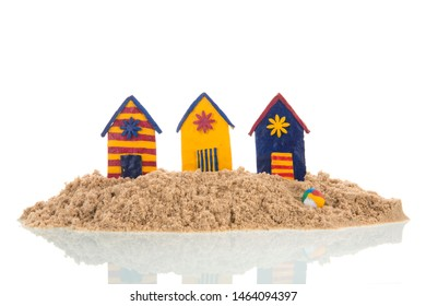 Island with colorful handmade beach cabins isolated over white background