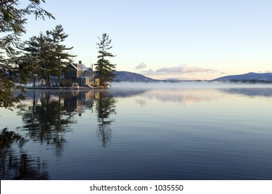Island with a cottage on the lake in the morning