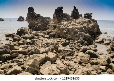 Island of cyclops Isola Lachea is one of the lava of Cyclopean Rock. Aci Trezza is a near Catania in Sicily, Italy.