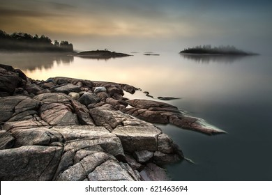 The island is in a fog. Karelia. Fog on the water.Early morning on the beach. Fog. Ladoga lake. Karelia. The Republic of Karelia.