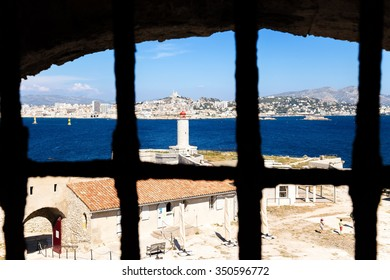 THE IF ISLAND, FRANCE - JUL 20, 2015: View from Castel of If prison cell. In the background, Marseille