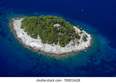 Island Galesnik is the first in a row of all Pakleni islands, at the very entrance of the port of Hvar. From this little island there is the most beautiful view at the town of Hvar. Shot from air.